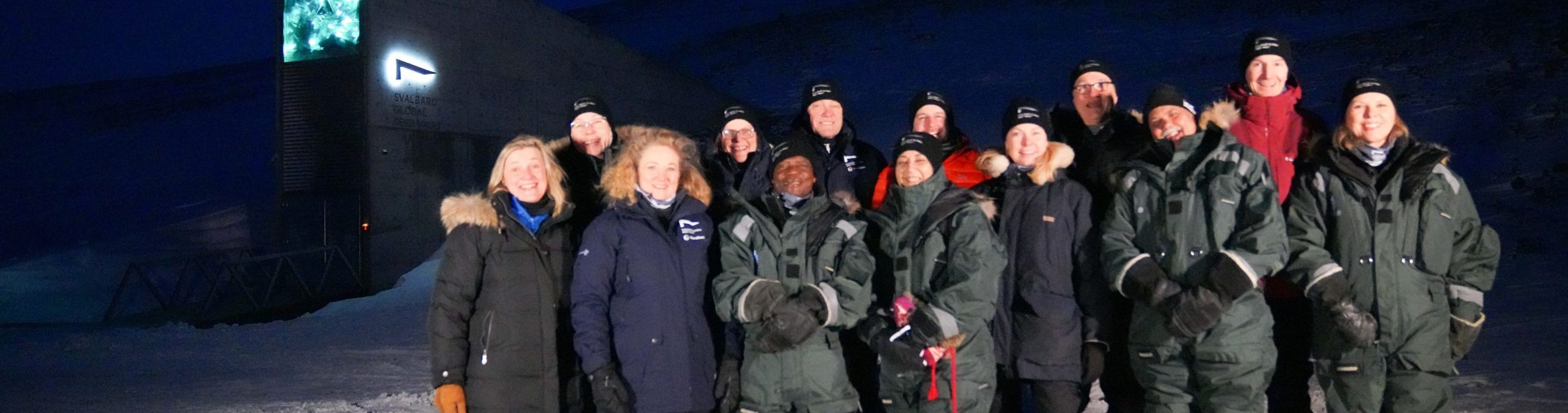 International Advisory Panel standing in front of Svalbard Global Seed Vault.
