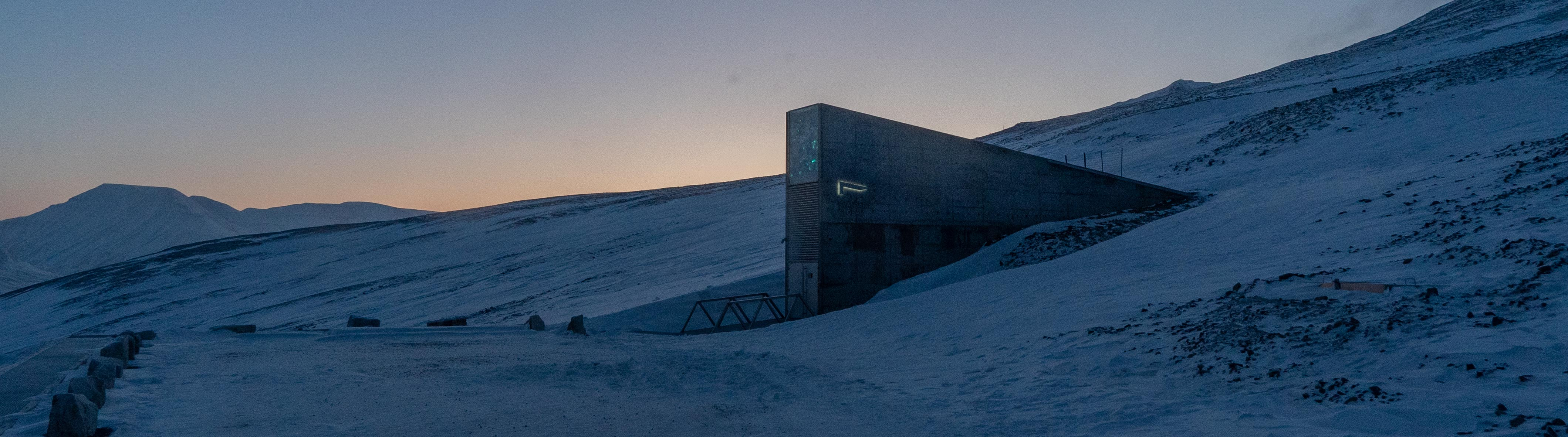 A winter landscape with the iconic entrance door to Svalbard Global Seed Vault.