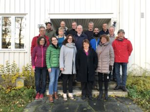 Participants in the project NORDFRUIT in front of a white building