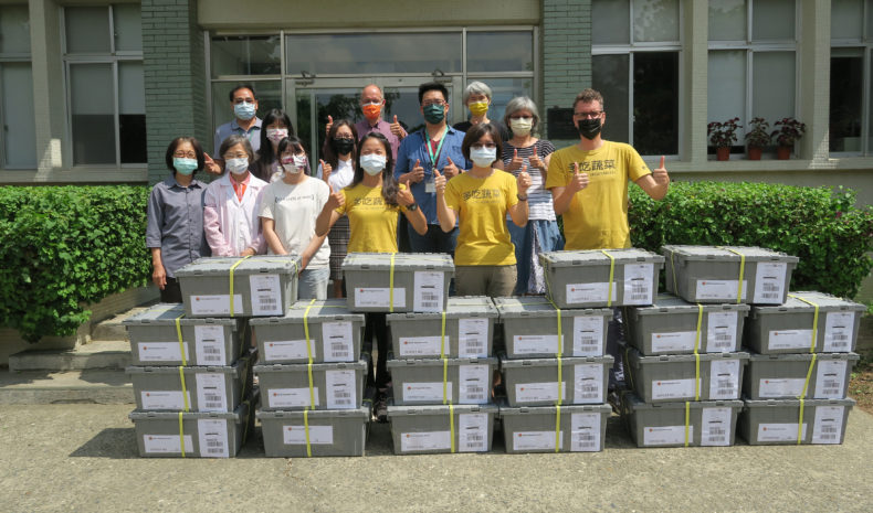 Personnel from WorldVeg show the current delivery with seed samples.